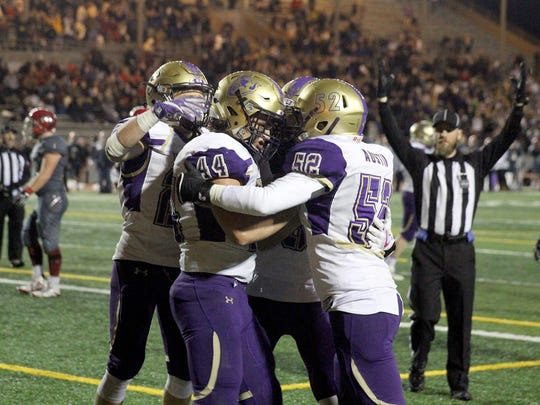 North Kitsap's Aidan Allsop, center, is congratulated after scoring a touchdown on a tipped pass against Archbishop Murphy at Veterans Memorial Stadium in Snohomish on Friday. North Kitsap saw its season end with a 28-21 loss in the state quarterfinals.