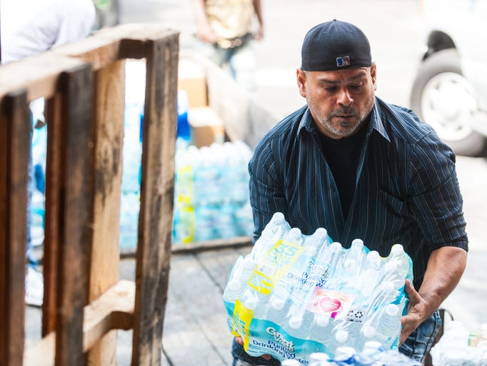 Efrain Rodgriguez unloads a truck of donations for