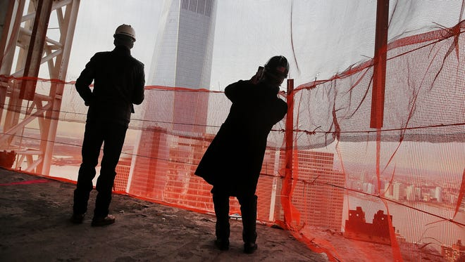 Employees of both Silverstein Properties and Tishman Construction Corporation walk around one of the top floors of the newly built Four Seasons private residences at 30 Park Place on Jan. 21, 2015, in New York City.