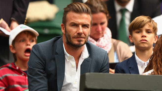 David Beckham and son Romeo Beckham attend day nine of the Wimbledon Lawn Tennis Championships at the All England Lawn Tennis and Croquet Club on July 8, 2015 in London, England.