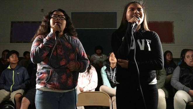 "In this March 8, 2016 photo, students Aaliyah Soto, from left, and Mia Granciano, sing during a music class at Stevenson Middle School in East Los Angeles. Los Angeles Unified School District, the nation's second largest, once had a $76.8 million budget for arts education, but years of cuts and layoffs wiped all arts classes from dozens of schools, leaving many students in the entertainment capital of the world with no music, visual arts, dance or theater instruction. That is slowly starting to change: The district is trying to enlist Hollywood studios to ""adopt"" LA Unified schools and provide them with equipment, mentorships and training."