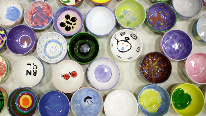 Painted bowls are lined up on a table during the Bowls of Hope event held at California Lutheran University in Thousand Oaks Sunday afternoon. Funds raised benefit Many Mansions.