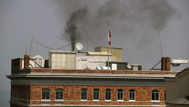 Black smoke billows from a chimney on top of the Russian consulate on September 1, 2017 in San Francisco, California. In response to a Russian government demand for the United States to cut its diplomatic staff in Russia by 455, the Trump administration ordered the closure of three consular offices in the San Francisco, New York and Washington.