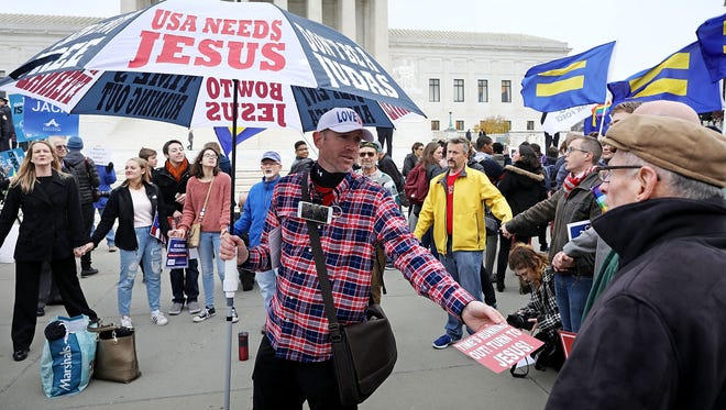 An evangelical Christian demonstrator rallies in front of the Supreme Court building in Washington, D.C., on Dec. 5, 2017, the day justices were to hear the case Masterpiece Cakeshop v. Colorado Civil Rights Commission.