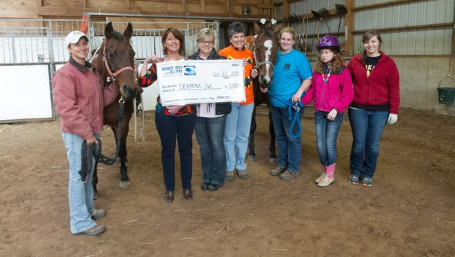 Women Who Care donated $5,000 to BEAMING, a horse therapy program for students and veterans based in Neenah.