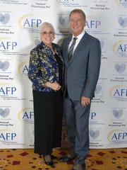 (left to right) Honoree Sandy Cooper Woodson and Gary