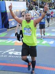 Former Shreveporter Shane Bison completes a marathon.