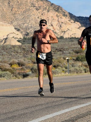 Stuart Kolb, pictured running in the St. George Marathon in 2016, will participate in his 100th career marathon Monday in Boston.