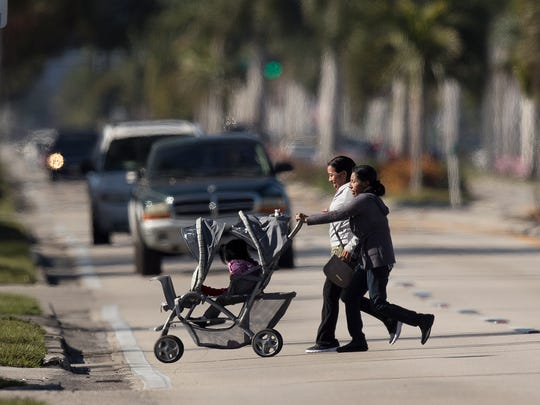 Pedestrians cross Palm Beach Boulevard on Tuesday. The Cape Coral-Fort Myers  area has been deemed the most dangerous metro area in the U.S. for walking. These women did not use a crosswalk.