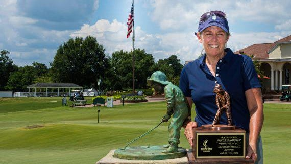 Savannah native Martha Stacy Leach of Hebron, Kentucky, with the Putter Boy trophy as the 63rd Women's North & South Senior Amateur champion.