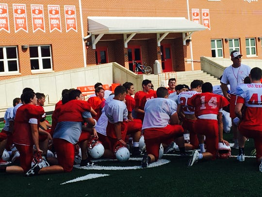 Beechwood head coach Noel Rash talks to his team after