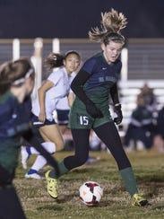 El Diamante's Carli Gordon takes the ball up field