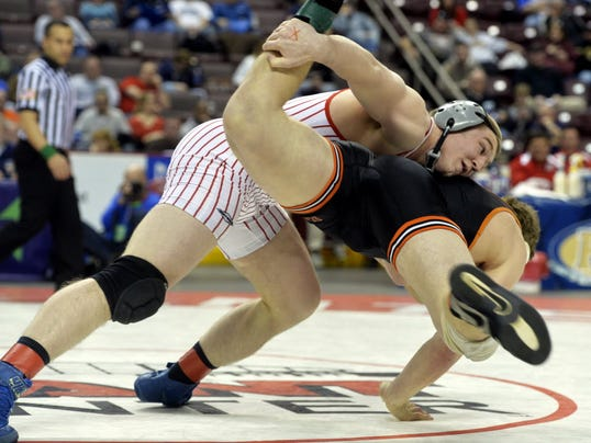 Bermudian Springs' Tristan Sponseller works Corry's Ryan Morris into a takedown in the PIAA Class 195-pound championship bout on Saturday, March 8, 2014. Sponseller defeated Morris 9-1 to win gold. (Chris Dunn -- York Daily Record)