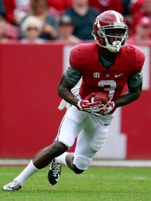 Alabama Crimson Tide wide receiver Calvin Ridley (3) returns a punt during the annual A-day game at Bryant-Denny Stadium.