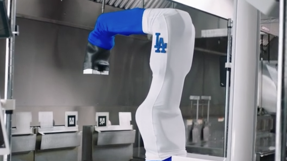 Flippy, the burger flipping robot, has a new gig: cooking chicken tenders at Dodger Stadium