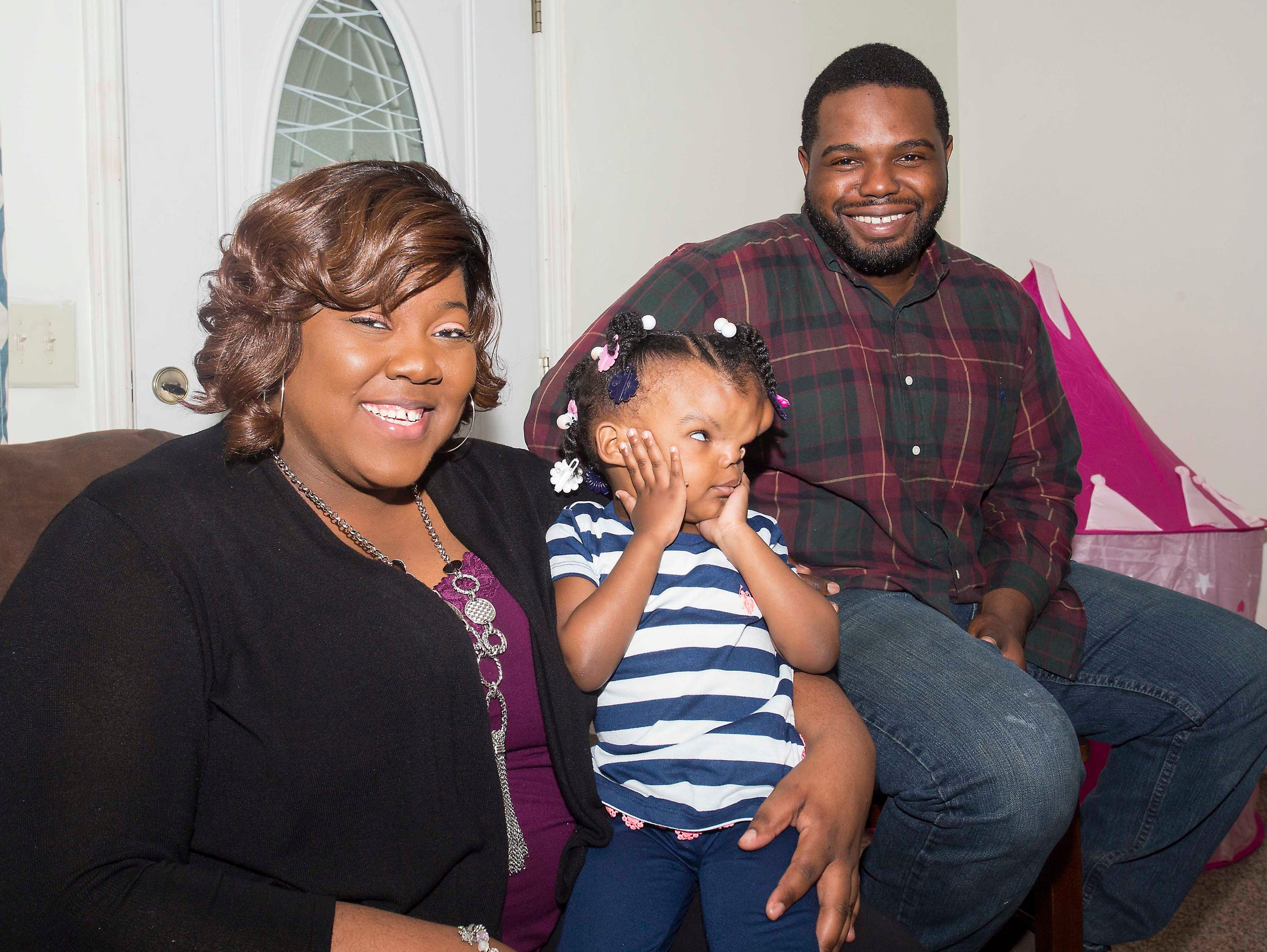 Tishana, left, and Quantrel Alford with their daughter,