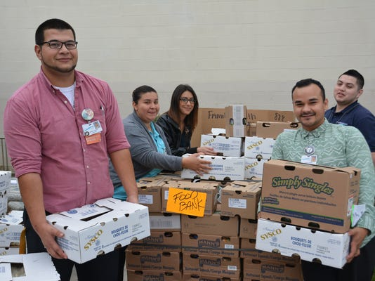 FHCN AmeriCorps volunteers unload food donations from the Community Food Ban.JPG
