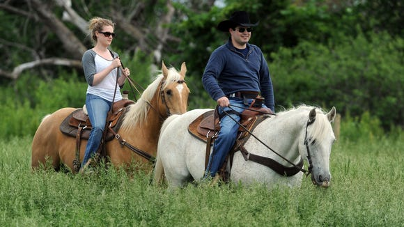 Billie and Kelsea Sutton ride horse on the family's