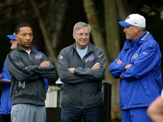 Buffalo Bills head coach Rex Ryan, right, talks with team owner Terry Pegula, center, and team manager Doug Whaley during an NFL training session Thursday at the Grove Hotel in Chandler's Cross, England.