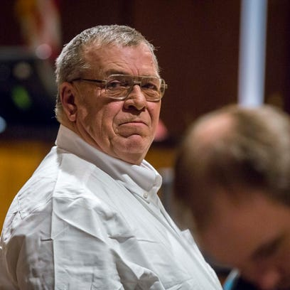 Dean Hilpipre, 61, of Alden stands after his sentencing
