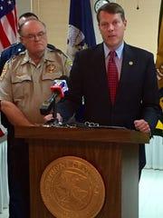 Winn Parish Sheriff Cranford Jordan (left) and acting U.S. Attorney Alexander Van Hook announce indictments against 21 people for drug trafficking in the Winnfield area.