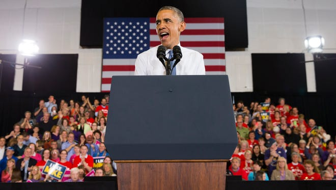 President Barack Obama speaks during a campaign rally for gubernatorial candidate Rep. Mike Michaud, D-Maine, on Thursday, Oct. 30, 2014, in Portland, Maine. (AP Photo/Evan Vucci)