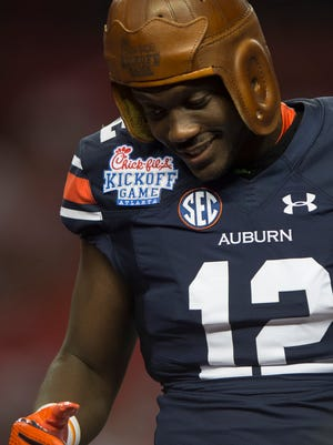 Auburn wide receiver Jonathan Wallace (12) wears the leather helmet after Auburn defeated Louisville 31-24 on Saturday, Sept. 5, 2015, in at the Georgia Dome in Atlanta, Ga.
