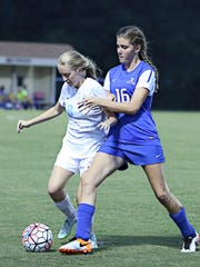 USJ's Maddy Puzdrakiewicz breaks up Jackson Christian's Sarah Miller as she tries to run at goal on Monday.