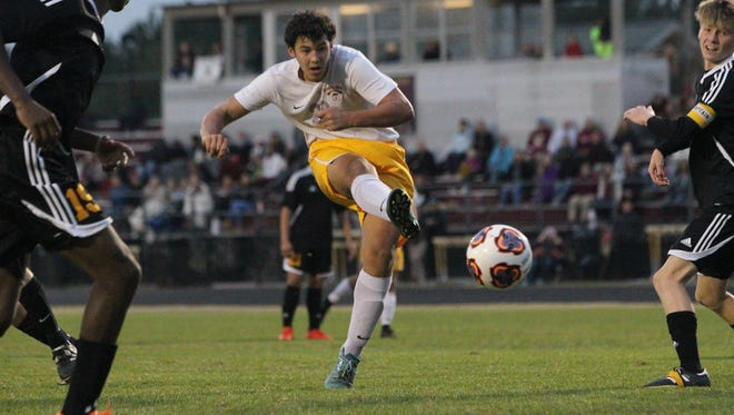 Florida High's Victor Castano boots a goal Saturday in the Seminoles' 7-0 win over Rutherford in the Region 1-2A semifinals. All three area schools, including Maclay and Leon, had shutouts.