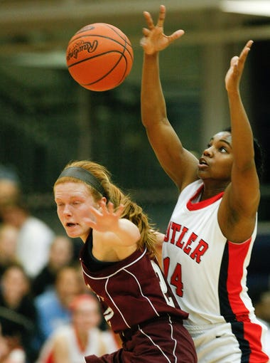 Butler's Danielle Lawrence, #14, forced Holy Cross's Rebecca Miller, #22, to cough up a loose ball during their game at the Valley High School. Mar. 6, 2014