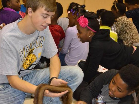 Toby Schreier of the Waupun FFA shows students a pelt in the Wildlife Session at Grantosa Drive Elementary School in Milwaukee as a part of the Waupun FFA Agriculture Day in Milwaukee.