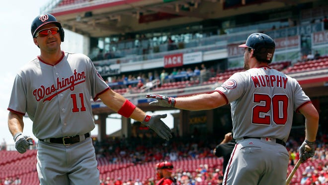 Washington Nationals first baseman Ryan Zimmerman (11) is congratulated by second baseman Daniel Murphy (20) after Zimmerman hit a solo home run against the Cincinnati Reds during the first inning at Great American Ball Park in Cincinnati on July 17, 2017.