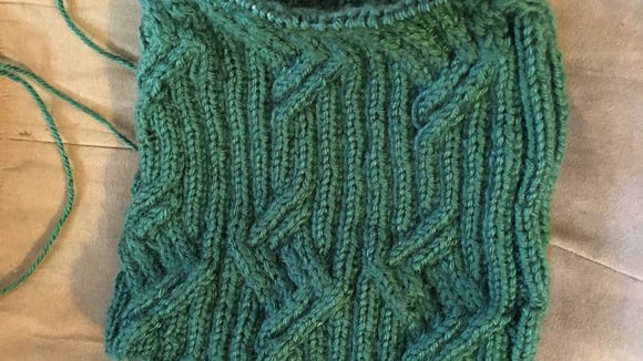 This is the Parallelogram hat I'm making for Alex. I keep following the wrong chart for the upper  cables.