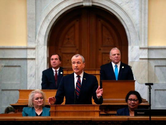 Assembly Speaker Craig Coughlin, left, and Senate President Steve Sweeney, right, listen as Gov. Phil Murphy delivers his first budget address on March 13, 2018.