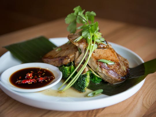 The new Buddha Barn in Sayler Park serves up Palo Moo (cinnamon ginger pork chops). It's grilled marinated pork chops topped with cinnamon ginger sauce served with steamed boo choy. The new Thai restaurant opened a couple months ago and is owned by chef Niruti Puakkawe, who goes by  Jack.