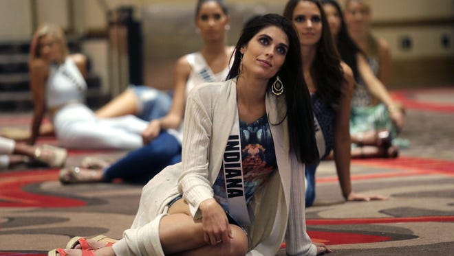 In this Monday, July 6, 2015 photo, Miss Indiana Gretchen Reece listens to instruction during rehearsal for the upcoming Miss USA Pageant, to be held this week in Baton Rouge, La. (AP Photo/Gerald Herbert)
