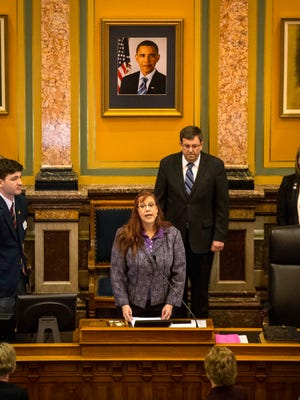 Deborah Maynard, a Wiccan priestess from the Cedar Rapids area, delivers the opening prayer Thursday April 9, 2015, in the Iowa House of Representatives at the Iowa Statehouse.