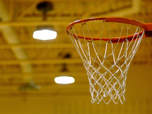 Empty basketball net in gymnasium
