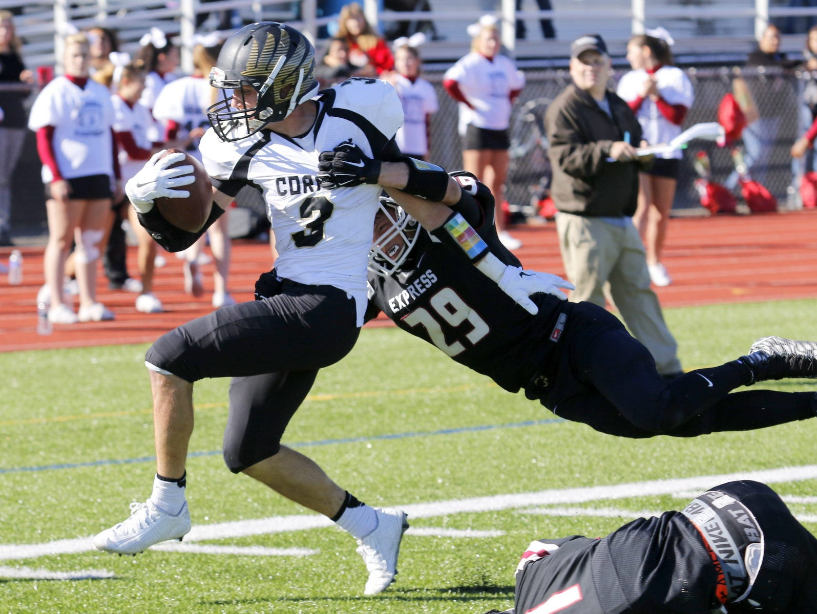 Elmira's Nick Root tackles Corning's Devon Sullivan short of the goal line during Saturday's Section 4 football game at Marty Harrigan Field.