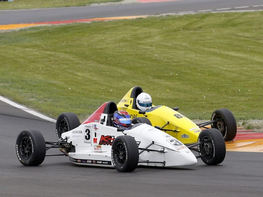 Neil Verhagen, in the No. 3 Mygale/Honda, battles wheel-to-wheel with eventual race winner Phillippe Denes, in the similar yellow car, through the Inner Loop on the final lap of F1600 support race Sunday at Watkins Glen International.
