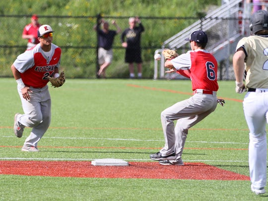 Ketcham second baseman Matt Lynch recives the ball from shortstop Jonnathan Cepeda to force out Corning's Zach Turner during Saturday's Class AA state quarterfinal at Corning Community College.