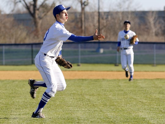 Mike Limoncelli of Horseheads fields a ball in a game in April.