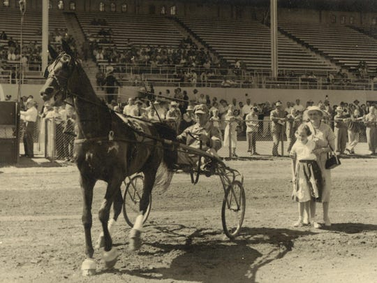 Veteran driver George Ramp after winning a harness race Sept. 4, 1956, with Mr. Frank, on the track at the Oregon State Fairgrounds.