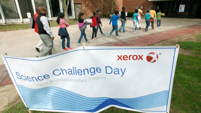 Students arrive to Science Challenge Day at Xerox in Webster on Tuesday. The event enlisted third- through sixth-graders from 16 Rochester and Webster schools in an Engineering Structures competition and an Invention Convention.