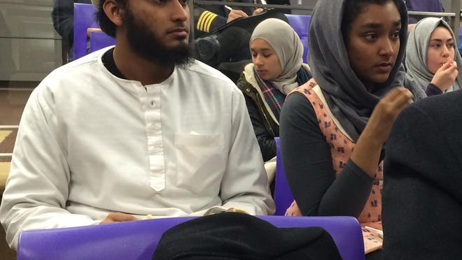 Talha Ghazi and his sister Haniawere among 100-some residents who attended Monday's community forum at the Farmington Community Library.