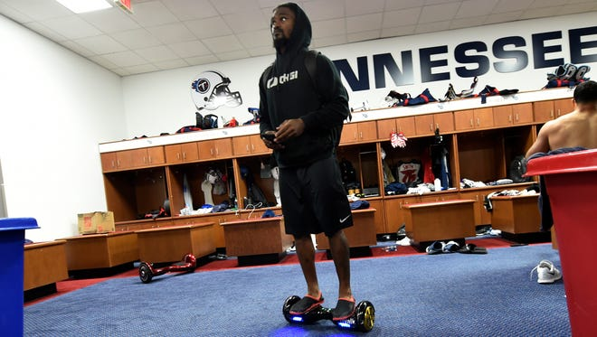 Titans cornerback B.W. Webb makes his way through the locker room on a hover board or personal transport device at St. Thomas Sports Park Thursday Sept. 24, 2015, in Nashville, Tenn.