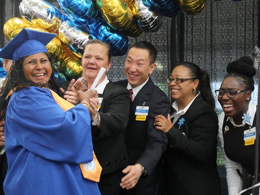 Walmart employees take part in a graduation ceremony in the company's North Bergen store. They have fulfiiled the qualifications necessary to become instructors so they could train other Walmart managers to do their job according to the company's policy.