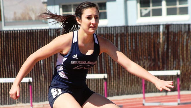 Silver Stage senior ChyAnn Campbell clears a hurdle in this 300 hurdles race at the 2014 Yerington Relays.