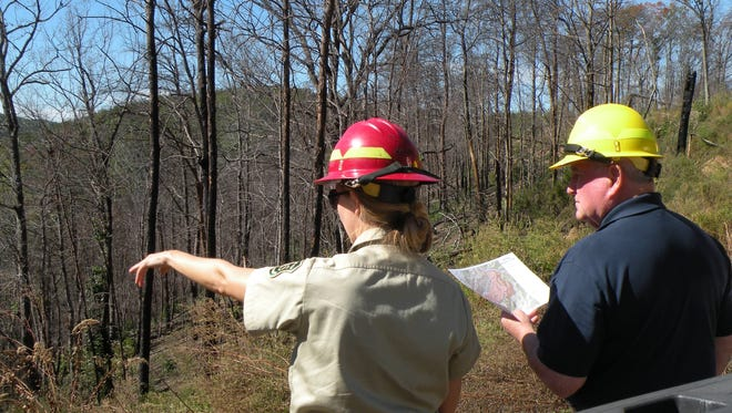 Amy McClave of the U.S. Forest Service points out fire damage to Agriculture Secretary Sonny Perdue during a visit to the Cherokee National Forest in early fall. A bill passed by a Senate committee Thursday would designate nearly 20,000 acres of the national forest as wilderness, giving it the highest level of protection.
