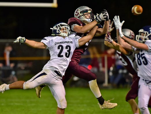 Chambersburg's Justin Reichenbach (23) breaks up a